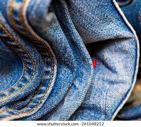 stitching on blue jeans, close-up. Shallow depth of field - stock photo