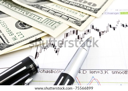 Stock business charts, dollar banknotes and a ballpoint pen - stock photo