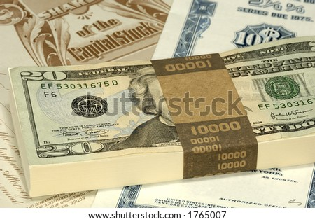 Stock Certificates and Cash - Shareholder Concept - stock photo