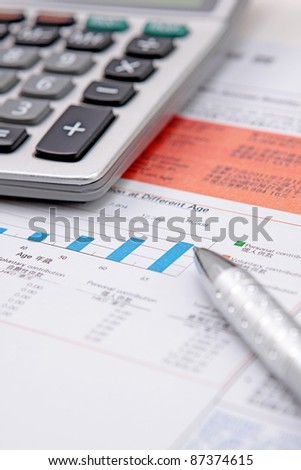 Stock chart with calculator,pen - stock photo