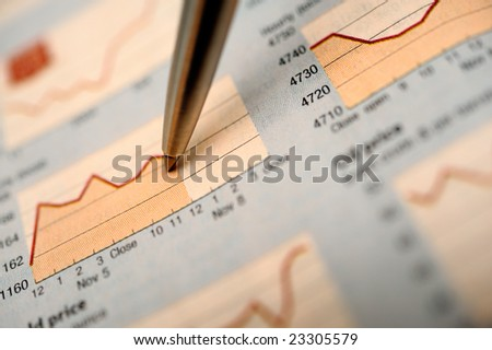 Stock charts and pen - stock photo