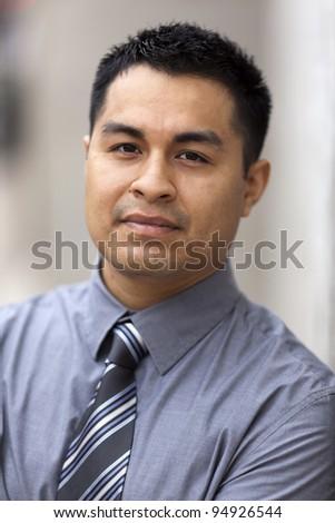 Stock closeup headshot photo of a Hispanic businessman. - stock photo