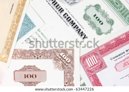 Stock exchange collectibles. Old stock share certificates from 1950s-1970s (United States). Vintage scripophily objects (obsolete). - stock photo