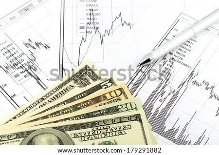 stock graph report with pen and usd money for business - stock photo