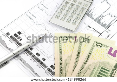 stock graph report with pen, calculator and usd money for business - stock photo