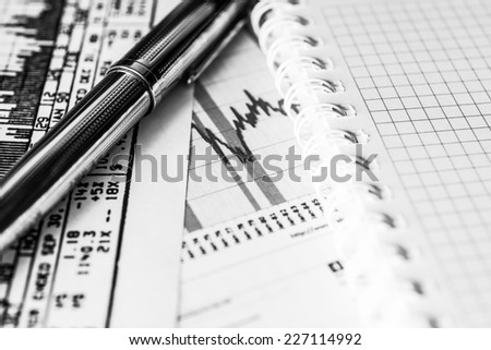 Stock graphic, write the result in the notebook - stock photo