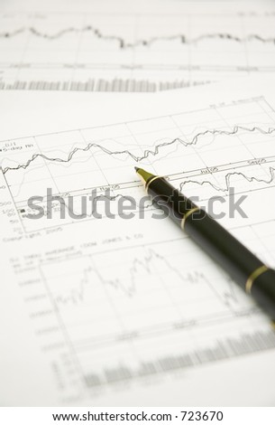 stock graphs and pen