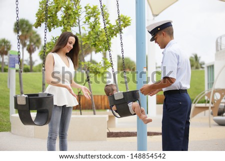 Stock image of a military family in the park - stock photo