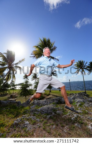 Stock image of a senior man jumping in mid air - stock photo