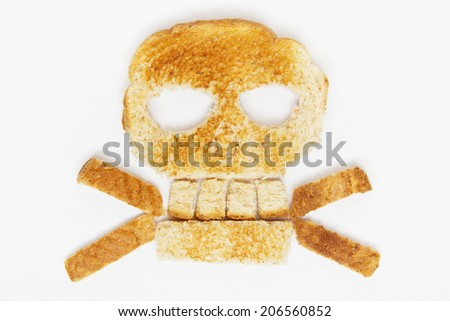 Stock image of bread skull and crossbones on white background - stock photo