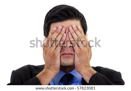 Stock image of businessman covering his eyes with his hands, over white background - stock photo