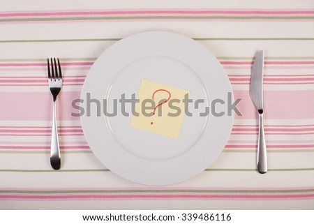 stock image of color note with question mark on white plate. diet concept - stock photo