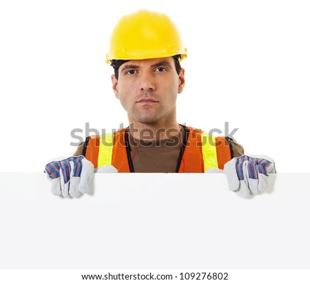 Stock image of construction worker holding blank sign withy copy space - stock photo
