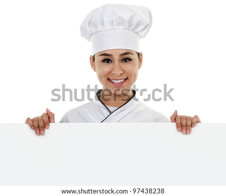 Stock image of female chef holding blank sign with copy space - stock photo