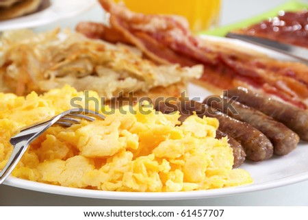 Stock image of hearty breakfast, focus on foreground. - stock photo