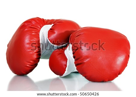 Stock image of red boxing gloves over white background - stock photo