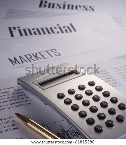 stock image of the calculator of business report - stock photo
