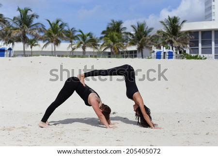 Stock image of two women in a yoga pose  - stock photo