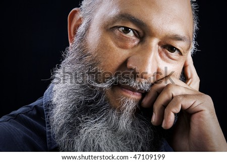 Stock image portrait of Man with long beard over dark background