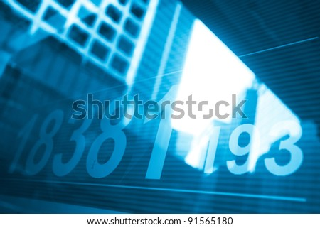stock index with building reflect on glass - stock photo