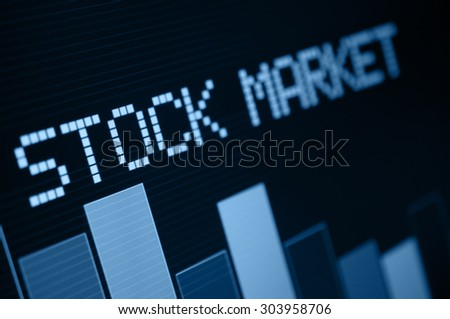 Stock Market - Column Going Down on Blue Display - Shallow Depth Of Field - stock photo