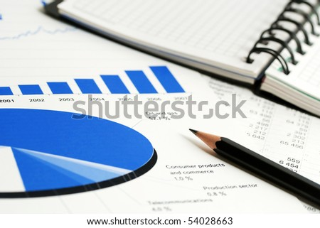 Stock market graphs and charts. - stock photo