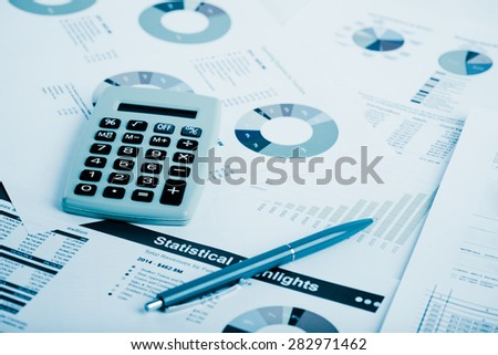 Stock market graphs and charts.  Blue toned - stock photo