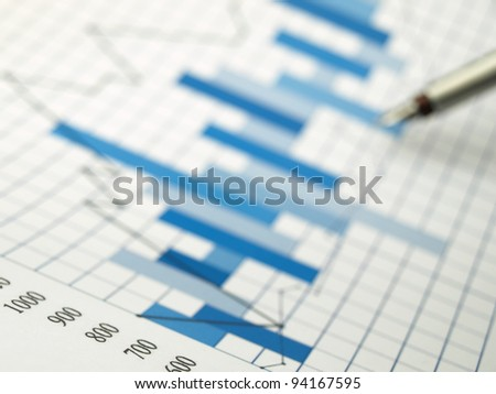 Stock market quotes (graph paper) - stock photo
