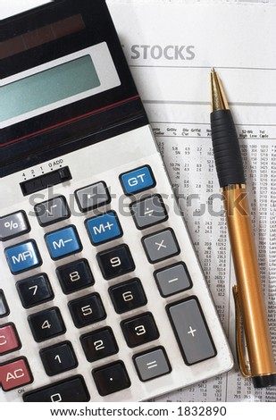 Stock market table analysis, calculator and pen indicates research and analysis - stock photo