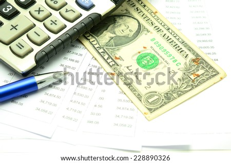 Stock market  with US dollars banknote and calculator