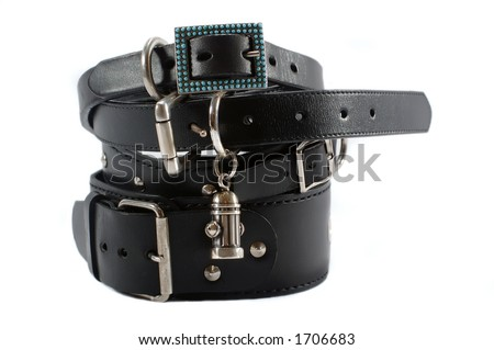 Stock of different black leather collars - stock photo