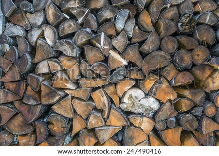 Stock of firewood at mountain guesthouse. A lot of pieces of firewood stored at village house. Different types of wood with different tone each. - stock photo
