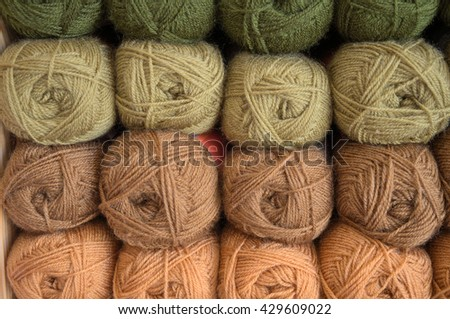 Stock of green and brown wool yarns. Hobbies and crafts - stock photo