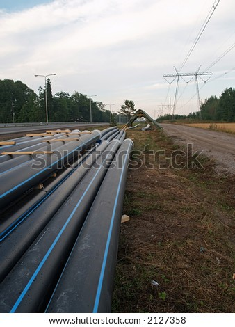 Stock of pipes in a field, close-up - stock photo