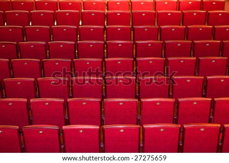 Stock photo: an image of many rows of red chairs