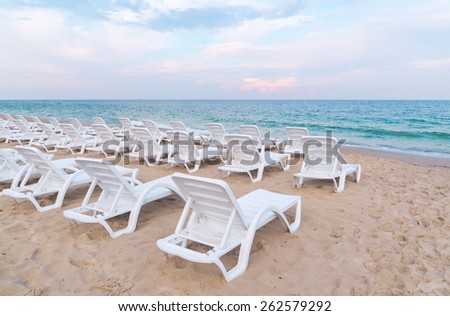 Stock photo beach chairs on the sand beach. - stock photo