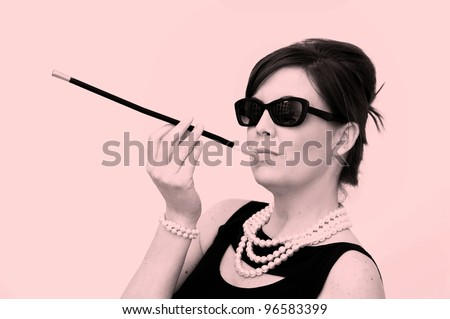 Stock Photo: beautiful woman brunette like Audrey Hepburn - stock photo