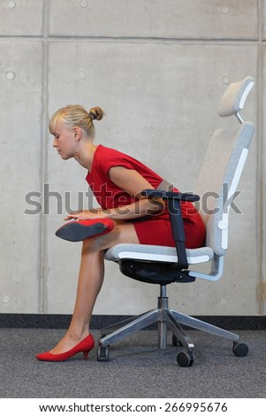 Stock Photo: break at work in office - relax on chair - business woman exercising  - stock photo