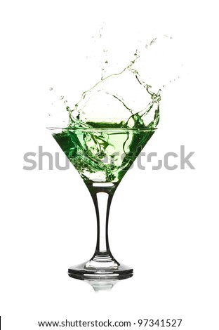 Stock Photo: green martini cocktail splashing into glass on white background - stock photo