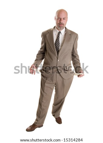 Stock photo of a well dressed broke businessman holding his empty pockets - stock photo