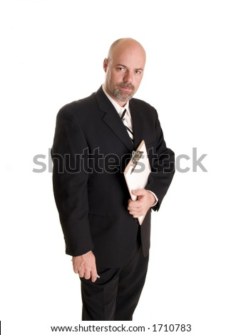 Stock photo of a well dressed businessman holding a clipboard. - stock photo