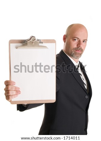 Stock photo of a well dressed businessman holding a clipboard.    Shallow DoF with focus on clipboard.
