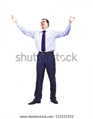 Stock photo of a well dressed businessman holding his arms up in a gesture as if addressing a crowd or requesting a congregation to rise. Approachable young business man with open arms isolated - stock photo