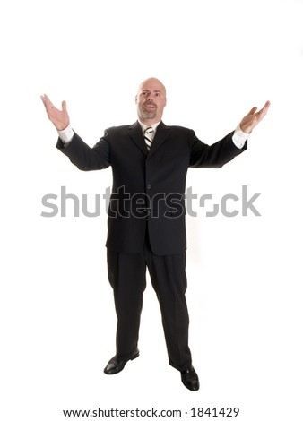 Stock photo of a well dressed businessman holding his arms up in a gesture, with a shocked expression on his face.  Full length, isolated white.