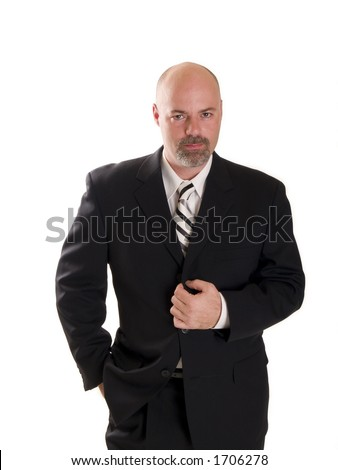 Stock photo of a well dressed confident businessman looking directly at the camera, isolated on white. - stock photo