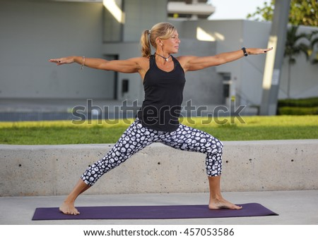 Stock photo of a woman in a warrior pose - stock photo