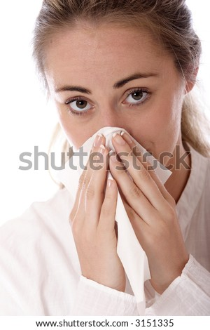 Stock photo of a young woman holding tissue, illness or allergy concept