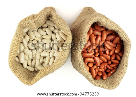 Stock Photo of White and Red Kidney Beans (legume, pulse) in burlap bags (sacks) view from top over white background. - stock photo