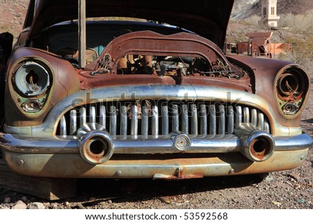Stock Photo:  Old rusted car in junk yard . National park Death valley - stock photo