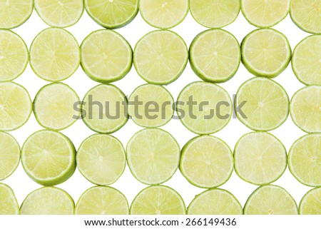 Stock picture of sliced limes on a row - stock photo